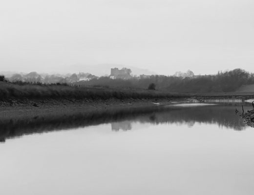 A shot of the River Ouse, misty, and in black and white.